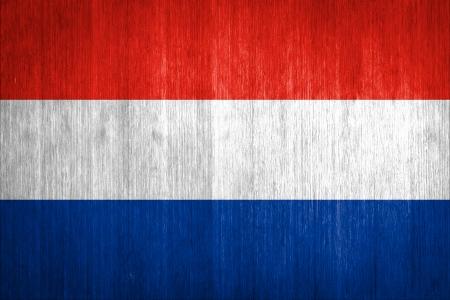 Netherlands Flag on wood background photo