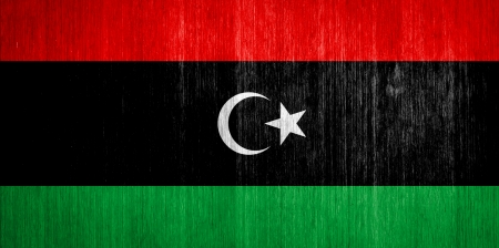 Libya  Flag on wood background photo
