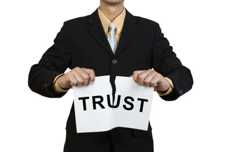 rend: Businessman tear paper with word Trust isolated on white background Stock Photo