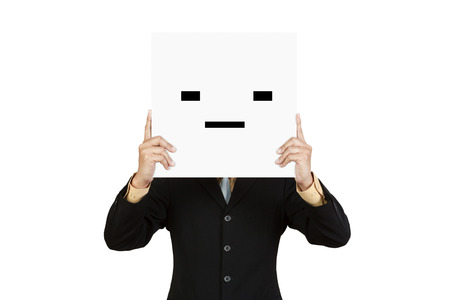 squint: Businessman hold board with squint face emoticon isolated on white wall Stock Photo