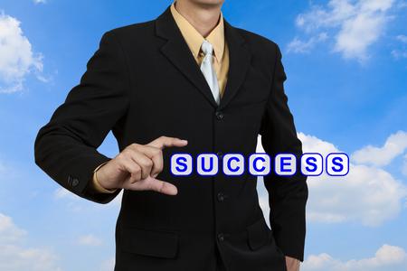 Businessman show word Success on blue sky   photo