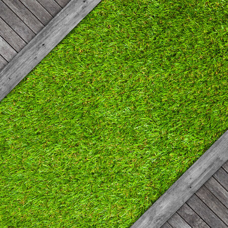 Wooden floor texture on artificial grass background photo
