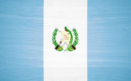 Guatemala flag on wood texture photo