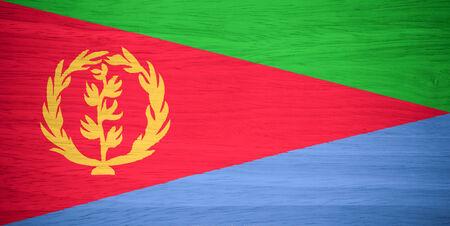 eritrea: Eritrea flag on wood texture Stock Photo