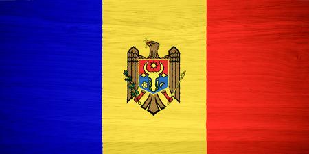 moldova: Moldova flag on wood texture