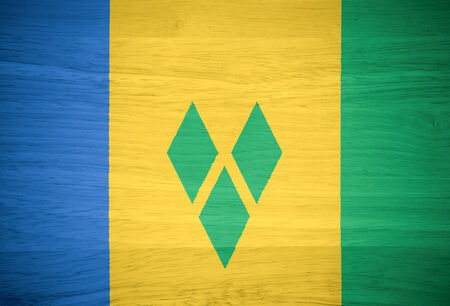 grenadines: Saint Vincent and the Grenadines flag on wood texture Stock Photo