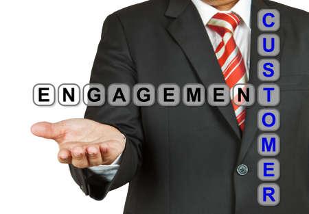 Businessman with wording Customer Engagement isolated on white background photo