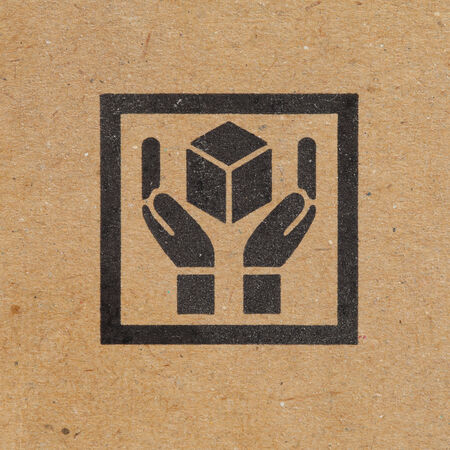 Hand handle package icon on paper box background photo