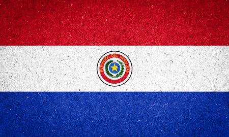 bandera de paraguay: Bandera de Paraguay en el fondo de papel Foto de archivo