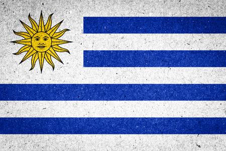 uruguay flag: Uruguay flag on paper background Stock Photo