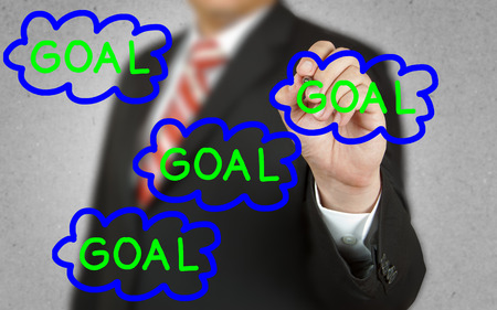 failed plan: Businessman drawing concept of Goal