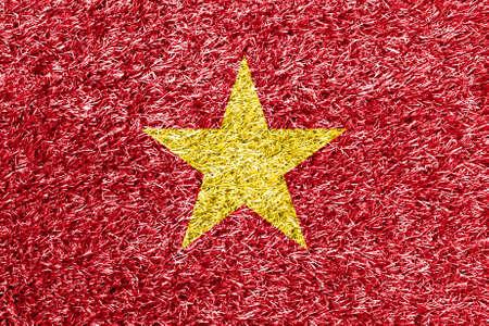 vietnam flag: Vietnam flag on grass background texture Stock Photo