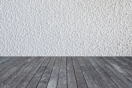 white wood floor: white cement wall background on wood floor