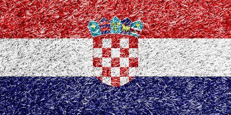 bandera croacia: Bandera de Croacia en la hierba textura de fondo