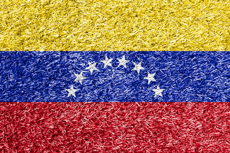 carpet clean: Venezuela flag on grass background texture
