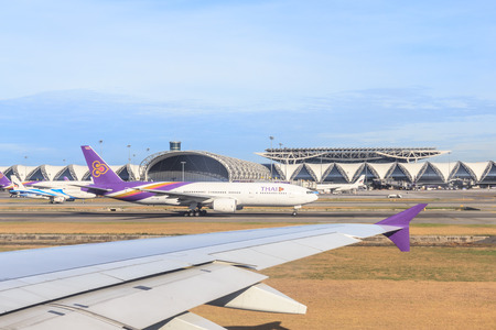SAMUTPRAKARN, THAILAND - MAY 21: docked flights in Bangkok Suvarnabhumi Airport. Suvarnabhumi Airport is one of two international airports serving Bangkok, Thailand on May 21, 2015