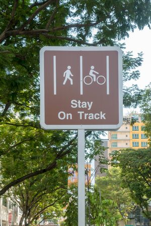 Stay on track sign beside a road