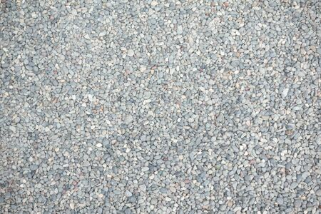 Abstract background of dry round stones in wide angle Stock Photo