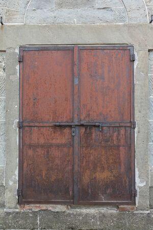 Old rusty metal closed door background texture