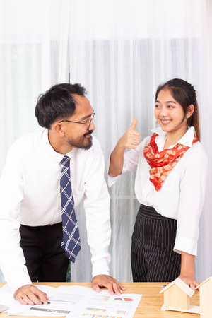 two asian male and female as business partner thumb up for the plan 版權商用圖片