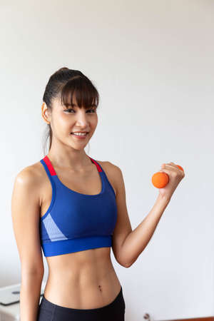 Sporty girl having weight exercise at home