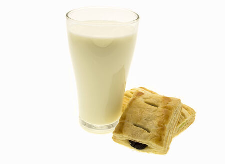 debauchery: Glass of milk and bread on white background