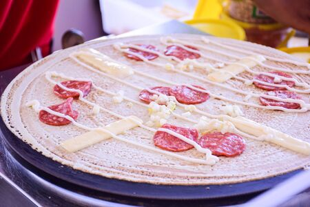 cook griddle: pancake made by a langkawi street vendor