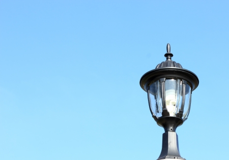one lantern on a blue sky background