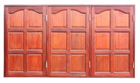 Three wooden window shutters were closed photo