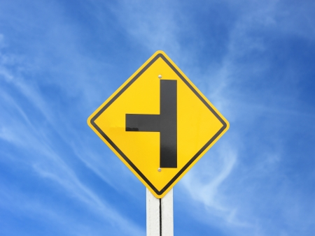 Yellow road sign on sky background