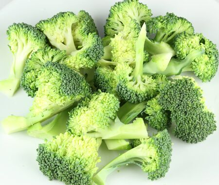fresh green broccoli on a  white background.