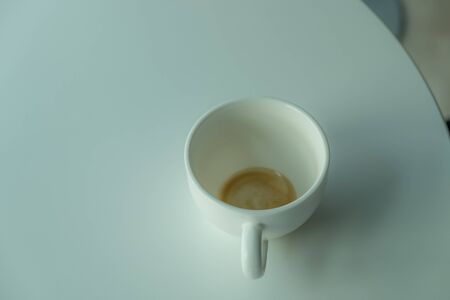 coffeecup: Empty cup of the coffee in evening light Stock Photo