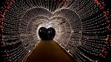 string lights: Beautiful heart string lights tunnel Stock Photo