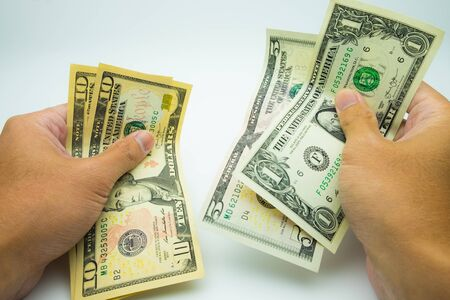 Hands holding USD bank notes