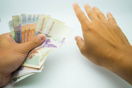 A hands holding KHR bank note with a hand