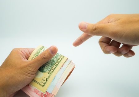 A hand grab bank notes and hand pointing