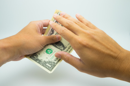 A hand grab a USD bank note a hand deny it