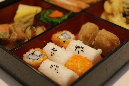 bento box: Japanese food in bento box with rolls, salmon and tempura