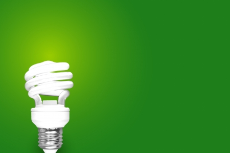 fluorescent: Compact Fluorescent Bulb on green background