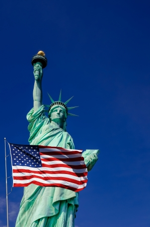 United States flag and Statue of Liberty in New York City photo