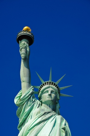 Statue of Liberty on blue clear sky, New York City, USA photo