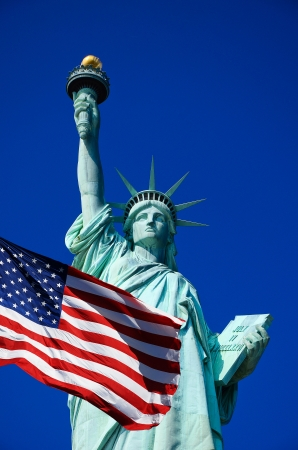 United States flag and Statue of Liberty in New York Cit photo