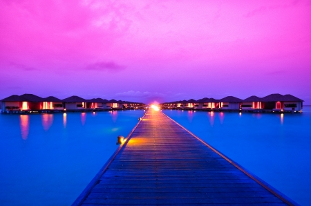 Sunset over island resort in Maldives