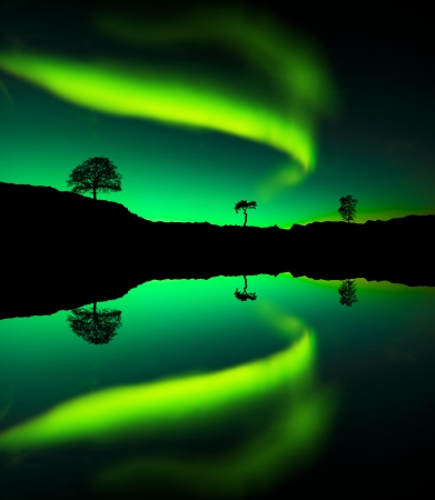 Northern lights Aurora borealis reflection on a lake photo