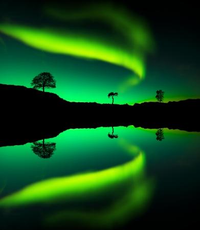 arctic zone: Northern lights Aurora borealis reflection on a lake