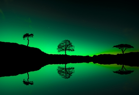 arctic zone: Northern lights Aurora borealis reflection on a lake