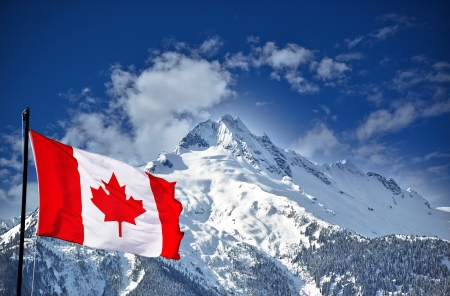 Canadian flag and beautiful mountain landscape