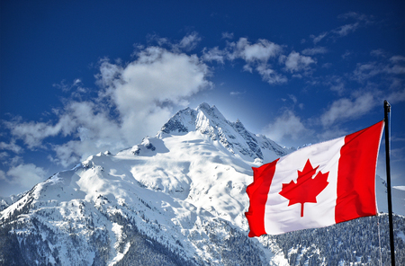 columbia: Canadian flag and beautiful mountain landscape