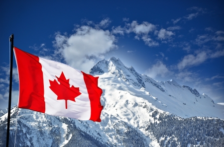 canada: Canadian flag and beautiful mountain landscape