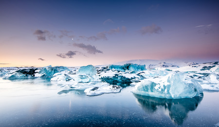 jokulsarlon: Icebergs floating in Jokulsarlon glacier lake at sunset. South Iceland. Stock Photo